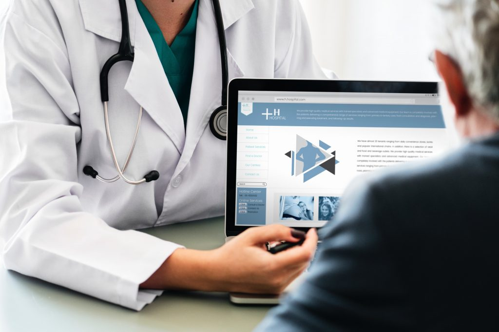 doctor points out additional medical information on her laptop to her patient
